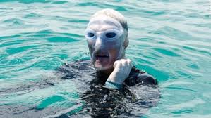 Nyad dons rubber mask to shield face from jellyfish stings.
